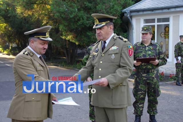 militari avansati in grad3 - FOTO: 22 de militari de la Brigada 8 LAROM au fost avansați în grad