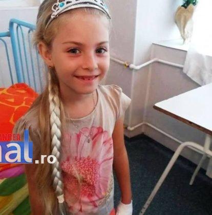 denisa savu1 414x420 - UMANITAR: Povestea Denisei, un copil bolnav care confecționează mărțișoare ca să plece la o clinică din străinătate